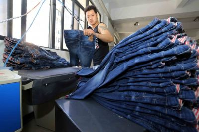 1777d1638c937b This picture taken on May 12, 2015 shows a Chinese worker making jeans at a  clothing factory in Shishi, east China's Fujian province. (STR/AFP/Getty  Images)