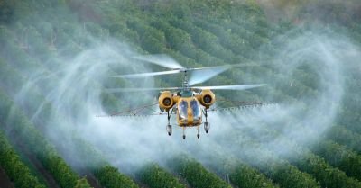 Monsantos herbicide glyphosate being applied via helicopter