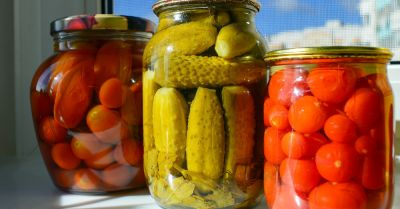 glass jars with canned pickles and tomatoes