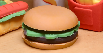 plastic burger with plastic hot dog, fires and shake