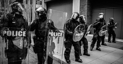 police in riot gear at a protest