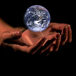 Set of hands holding the planet Earth