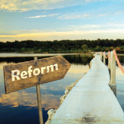 sign that says REFORM and an arrow pointing down a walkway