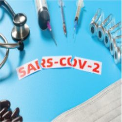 SARS-CoV-2 surrounded by a stethoscope and syringes