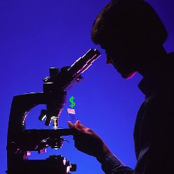silhouette of a scientist in front of a microscope with a dollar sign on their slide