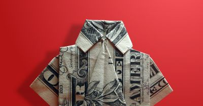 US dollar bill folded into a miniature mens shirt