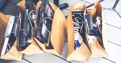brown paper shopping bags filled with gift purchases