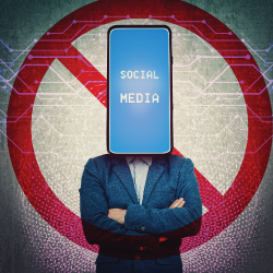 person with crossed arms and a cell phone for a head with the words SOCIAL MEDIA on the screen and a red circle with a slash in the background