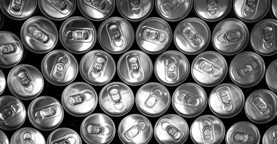 overhead view of several soda pop can lids