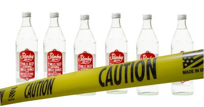 Starkey Spring Water surrounded by yellow CAUTION tape