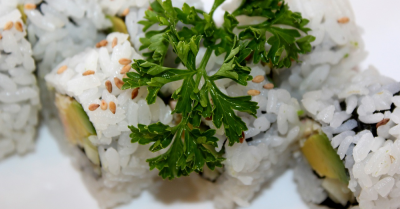 sushi rolls with a sprig of parsley