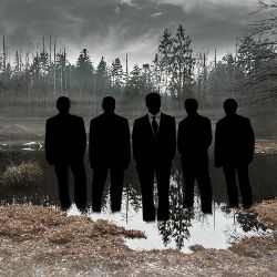 Silhouettes of businessmen in a foggy swamp