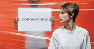 woman with the words 'CORONAVIRUS' behind her.