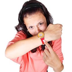 Woman pointing at her watch