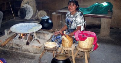 Mexican woman cooking handmade tortillas