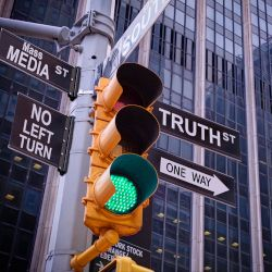 traffic light in NYC with signs pointing to MASS MEDIA and TRUTH