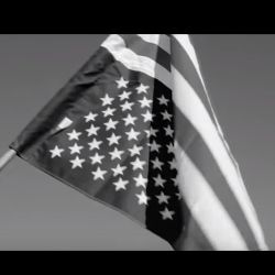 upside down black and white American flag