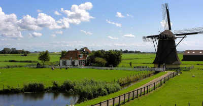 farm in the Netherlands with a windmill