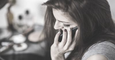 black and white image of a woman talking on a cell phone