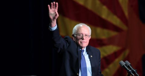 Presidential candidate Bernie Sanders giving a speech at a podium