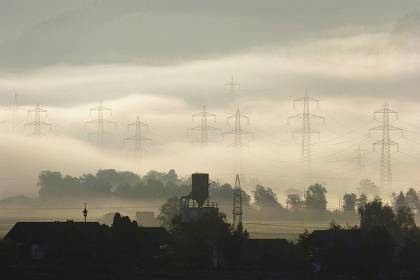 Industrial farm with fog and power lines