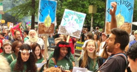 people holding signs during the Peoples Climate March protest