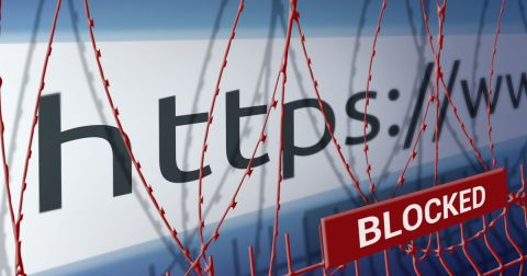Close up of url scheme with barbed wire over image