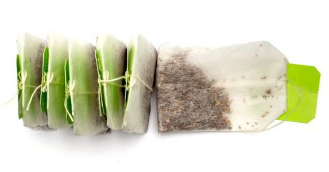 row of tea bags with green tags