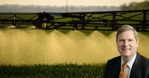 Tom Vilsack and spraying pesticides on a farm field crop