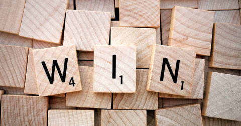 Scrabble tiles spelling 'WIN'